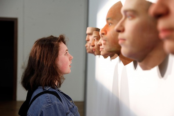 Visitor viewing Stranger Visions by Heather Dewey-Hagborg. Courtesy 3D Natives.